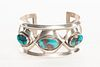 A Navajo Three Stone Bisbee Turquoise and Silver Cuff Bracelet