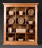 Small Collectible Basket Collection in Display Cabinet