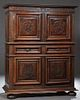 French Renaissance Style Carved Oak Homme Debout, 19th c., the stepped crown above double cupboard doors with geometric relief decor...