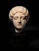 A Roman Marble Portrait Head of the Empress Faustina Minor Height of marble 12 inches.