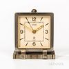 LeCoultre Art Deco Alarm Desk Clock, chrome-plated brass case with ivory-tone dial, applied gilt indices, and arabic numerals at 12-3-6