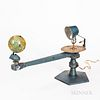 Unmarked Cast Metal Tellurion, manual gear-driven 4-in. dia. two-part tin globe, paper zodiac dial below the electric socket, manual-wi