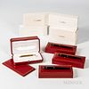 """Cartier 18kt Gold 150th Anniversary Mini Roller Ball Pen and Three Others, a """"Diabolo de Cartier"""" rollerball and fountain pen set in re"""