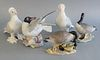 "Five Boehm porcelain birds, titles include: Laughing Gull, Tumbler Pigeons, and Canada Geese, all three stamped to the underside, each ht. 8 1/2""."