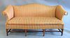 """Southwood camelback sofa, Hepplewhite-style mahogany tapered legs with stretchers, ht. 33"""", wd. 80"""", dp. 25""""."""