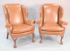 """Pair of Kindel Winterthur Collection brown leather Chippendale style wing chairs, ball and claw feet. 44"""" x 39"""" x 20-1/2""""."""