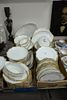 Large group of scallop-edged Limoges plates, serving platters, and gravy bowls, each stamped to the underside.
