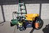 Group lot to include a power sprayer, shop vac, spreader, wheel barrel, tool box, and ladder.