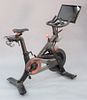 """First Generation Peloton Stationary bike, along with size 44 Peloton spin shoes., approximately 44"""" x 54"""" x 24""""."""