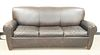 """Pottery Barn three-cushion sleeper sofa with brown leather, ht. 33"""", wd. 82"""", dp. 36""""."""