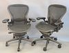 """Pair of Herman Miller executive office armchairs on swivel bases, adjustable ht. 38 1/2""""."""