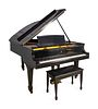 A Steinway Model L Grand Piano and Bench Length 5'10 inches.
