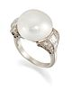 AN NATURAL SALTWATER PEARL AND DIAMOND RING, the pearl in a