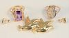 Four Piece Gold Lot to include amethyst ring, scarab ring, bird brooch, and dolphin earrings 13 grams total weight
