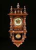 A GUSTAV BECKER CARVED WALNUT WALL CLOCK, MARKED, GERMAN, 1877-1926,