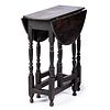 A William and Mary Black Painted Oak Gate-Leg Table, English, Circa 1700