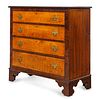 A Chippendale Mahogany and Tiger Maple Chest of Drawers, New England