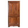 A Chippendale Paneled Walnut Corner Cupboard, Likely Kentucky, Circa 1800