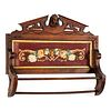 A Victorian Carved Walnut Hanging Rack with Inset Floral Needlepoint Panel