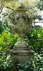 An English Monumental Carved Stone Urn on a Pedestal Base Height 9 feet 8 inches x width 3 feet 5 inches.