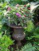A Pair of Cast Iron Campana-form Garden Urns on Pedestals Height 27 x diameter 15 inches.