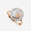 An opal, diamond, and eighteen karat gold ring,