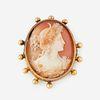 An eighteen karat gold and cameo brooch,