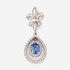 A sapphire, diamond, and eighteen karat white gold pendant,