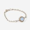 A chalcedony, diamond, and fourteen karat white gold, and white metal bracelet,