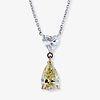 A fancy light yellow diamond, colorless diamond and fourteen karat bi-color gold pendant necklace,