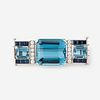 A topaz, sapphire, diamond, and eighteen karat white gold clasp,