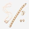 A four piece fourteen karat gold and coral suite,