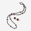 A fourteen karat gold and lapis lazuli necklace with matching earrings,