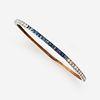 An eighteen karat gold, diamond, and sapphire bangle,