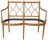 Edwardian Double Chair Back Settee, with paint decoration, 19th Century, (no seat), height 36 inches, width 44 inches.