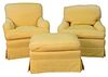 Two Easy Chairs, in custom yellow upholstery, one with loose back and seat cushions (sun faded), seat height 18 inches; along with one ottoman.
