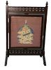 Victorian Oak Fire Screen, with revolving needlepoint panel, height 46 inches, width 30 inches.