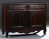 French Provincial Louis XIII Style Carved Walnut Sideboard, early 20th c., the rounded edge canted corner top over two frieze drawers and double arche
