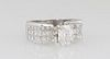 Lady's Platinum Dinner Ring, with a 1.52 ct. radiant cut diamond, flanked