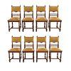 Lote de 8 sillas. Francia. Siglo XX. Estilo Enrique II. En talla de madera de nogal. Con respaldos semiabiertos.