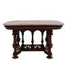 Mesa.  Francia.  Siglo XX.  Estilo Enrique II.  En talla de madera de nogal.  Decorada con elementos arquitectónicos.