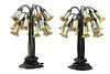 A Pair of Art Nouveau Style Patinated Metal and Iridescent Glass Eighteen-Light Tulip Lamps