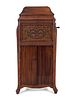 A Silvertone Carved and Stained Wood Tall Case Phonograph