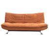 Sofá - cama. Siglo XX. Estructura de madera. Con respaldo y asiento en tapicería color naranja. Soportes metálicos semi curvos.