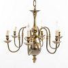 Lámpara de techo. Siglo XX. Estilo holandés. Elaborado en latón dorado Para 6 luces. Fuste compuesto con motivo boleado.