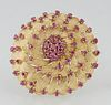 Vintage 18K Yellow Gold Circular Brooch, the center dome mounted with a central round ruby atop double concentric graduated rows of small round rubies