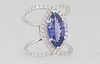 Unusual Lady's 18K White Gold Dinner Ring, with a 5.63 carat marquise tanzanite atop a double split band mounted with round diamonds, total diamond wt
