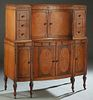 American Inlaid Mahogany Art Deco Tall Chest, 20th c., the concave double doors flanked by banks of three drawers, and reeded pilasters, on a bowfront