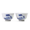 A PAIR OF BLUE AND WHITE FIGURES CUPS