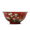 A CHINESE RED-GROUND FAMILLE ROSE FLOWERS BOWL